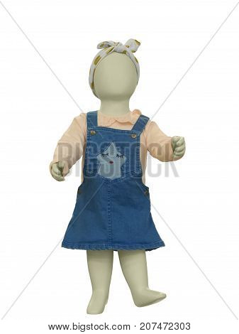 Full-length child mannequin dressed in casual clothes isolated on white background. No brand names or copyright objects.