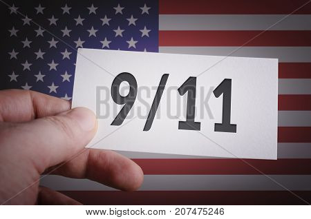 Never forget 9/11 card in hand with USA flag background