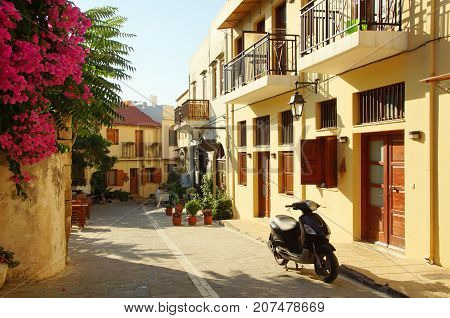 Sunny morning on the narrow street of the old city in Rethymnon Greece