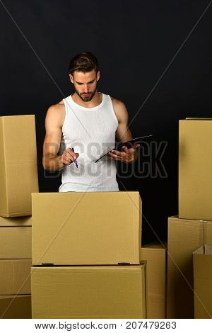 Guy With Clip Board Checking On Amount Of Boxes
