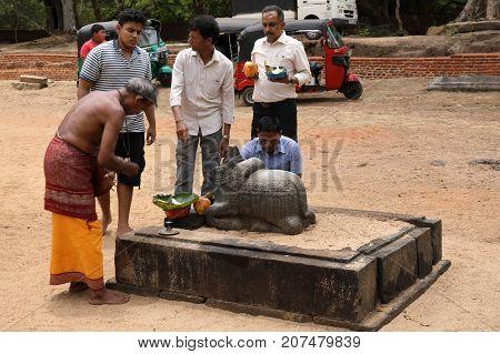Hindu ceremony in the ruins of Polonnaruwa in Sri Lanka, 04. August 2017