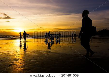 Kota Kinabalu Malaysia - September 05 2016: Silhouettes of beach goers at Tanjung Aru beach located in Kota Kinabalu Sabah Borneo Malaysia. Tanjung Aru is a famous beach among local and tourists.
