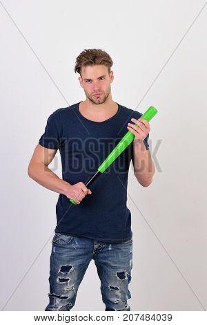 Guy In Blue Tshirt Holds Bright Green Bat For Baseball
