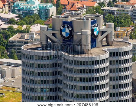 June 12 2017. Close-up aerial view of the top of the BMW-Vierzylinder tower headquarters of the German automobile company BMW. Munich Germany. Travel and business editorial concept.