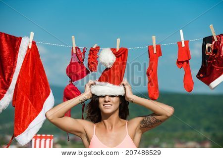Santa Claus Girl Hanging Clothes For Drying.