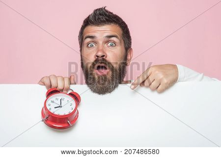 Man With Long Beard Hold Alarm Clock.