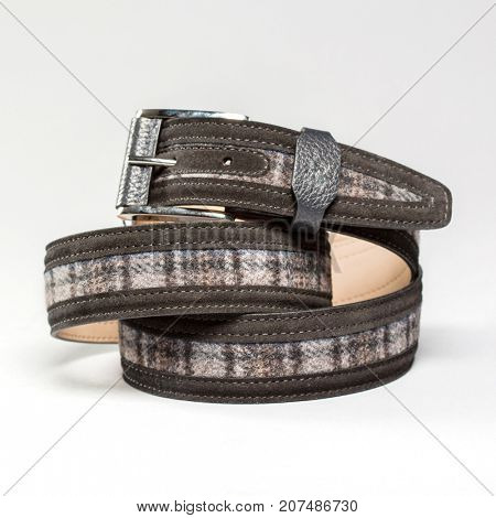 Men fashionable leather belt on a gray background