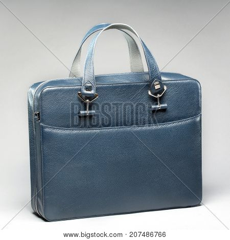 Leather blue stylish business case on a gray background
