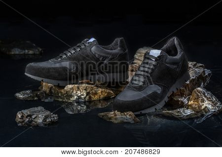 Stylish men shoes for autumn on a black background