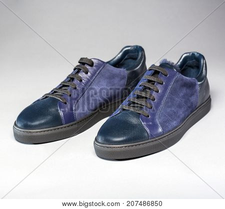 Leather fashion shoes on a gray background