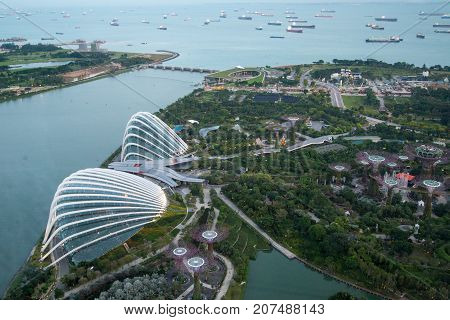 January 3 2017. Wide angle aerial view of the Gardens by the Bay with the Supertree Grove Greenhouses and the ocean visible in the evening Singapore. Travel and landmarks editorial concept.