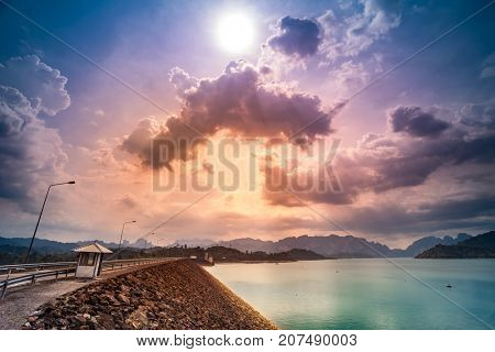Ratchaprapa Dam or Chiao Lan reservoir , Suratthani Thailand. Colorful sunset cloudy sky in the background. Nature landscape