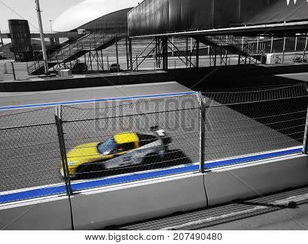 a racing car rides with speed on a racing track