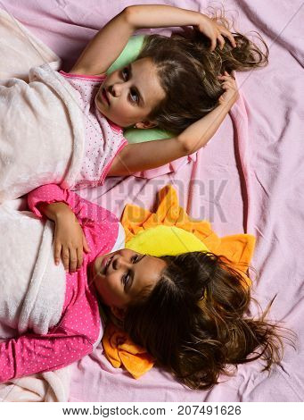 Kids With Dreamy Faces And Loose Hair Lie In Bed