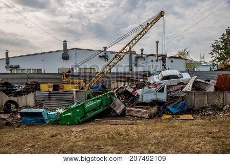 Scrap car recycling yard. Utilizing of old cars