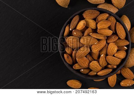 Almonds On A Dark Background