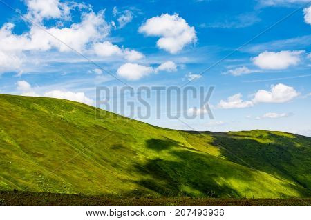 Green Alps Under Blue Sky