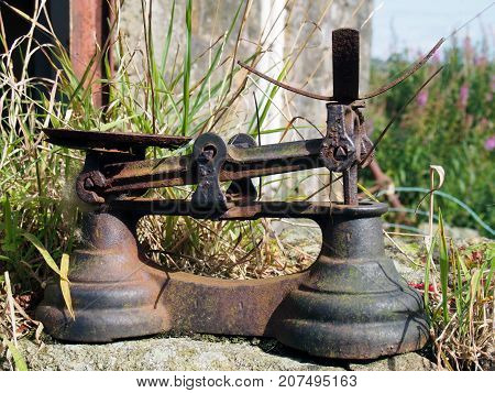 pld rusty balance scales outdoors in a country setting