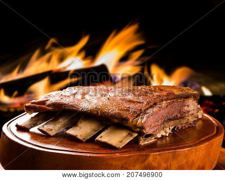 Barbecue ribs traditional Brazilian barbecue. fire background