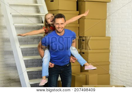 Daughter And Father Near Piles Of Boxes