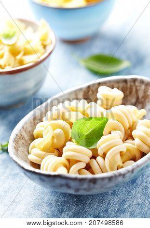 Dried pasta in a ceramic bowl