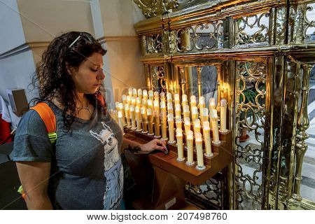 Palermo.Italy.May 26 2017.A girl lights electronic candles in the Cathedral of SANTA Maria Assunta in Palermo. Sicily