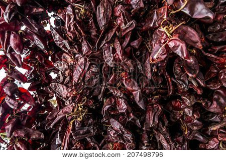 ligament pods of dried hot red pepper at the market
