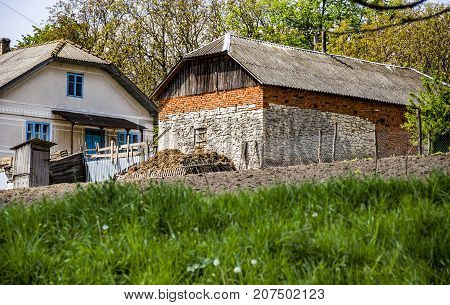 a big brick barn in the countryside