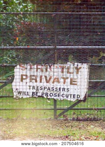 Old Battered Worn And Weathered Strictly Private Trespassers Will Be Prosecuted Sign