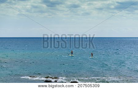 Stand Up Paddling in the blue sea