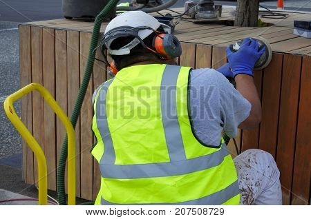 Manual Worker Sanding A Wooden Surface
