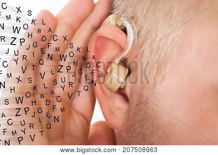Man Holding Hand Near Ear Listening Carefully Alphabet Letters Flying Using Hear Aid