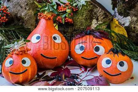 Autumn Pumpkin family congratulates on the holiday Helloween on Forest Background.