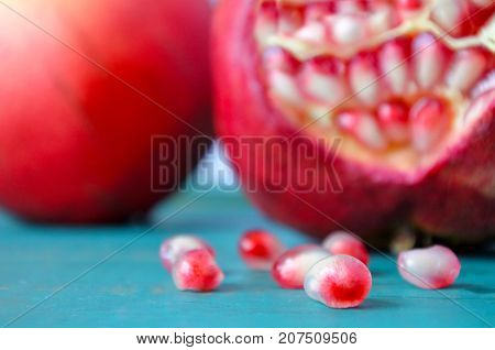 Two Pomegranate.fruit And Seeds