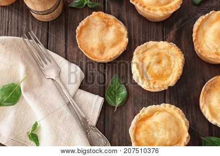 Delicious meat mini pies on table