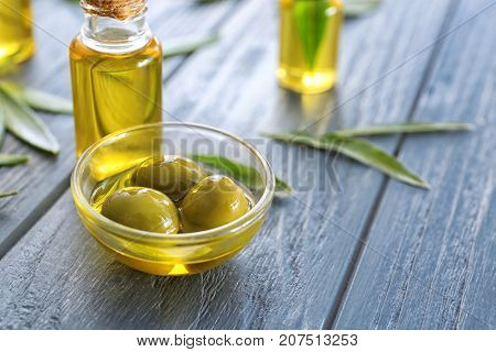 Glassware with olive oil on wooden table