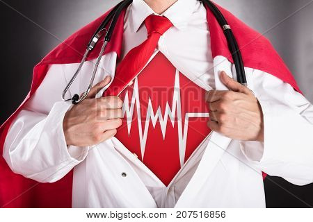Close-up Of Superhero Doctor Opening Shirt For Showing Heartbeat Sign