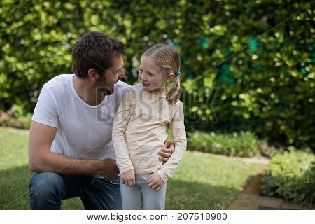 Father and daughter interacting in the park