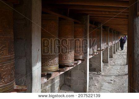 The Tibetan kora or pilgrimage and prayer wheels in Zoige Amdo Tibet - China. Pic was taken in September 2017. poster