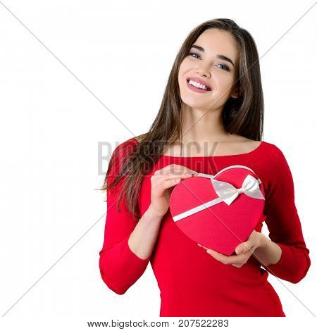 Beautiful happy smiling young woman holding red heart gift box with valentine's present inside, isolated on white background. Valentine's day image.
