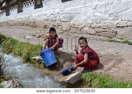 The Child Monks Around Kirti Gompa Monastery In Langmusi, Amdo Tibet