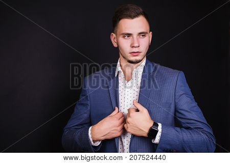 Successful young business man in business suit and white shirt and fashionable clock on hand. Stylish business man. Man professions. Business concept. Business vision. Successful business man in a classic suit