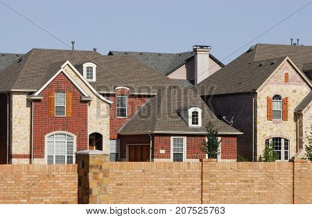 luxury houses inside wall surrounded community in the city