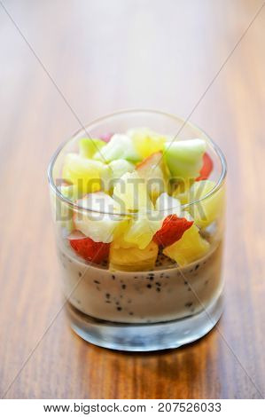 panna cotta with fruit on wood table