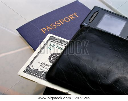 Close Up Shot Of Passport, Walet, Phone And Bill