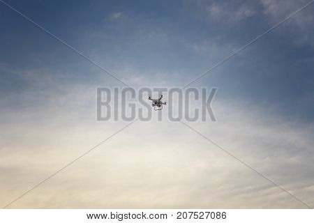 The Drone on the evening sky background.