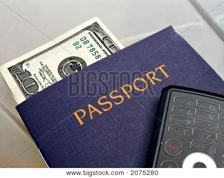 Close Up Shot Of Passport, Phone And Dollar Bill