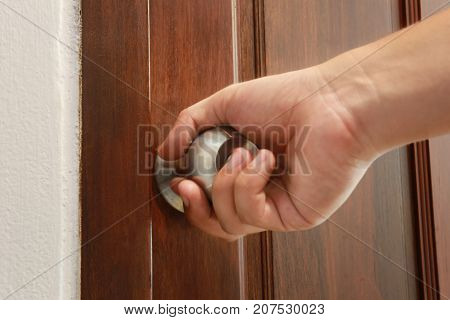 man use hand is opening the doorconcept of beginning in new things and courage.