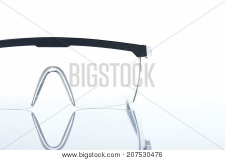 Working protective glasses close-up isolated on white background