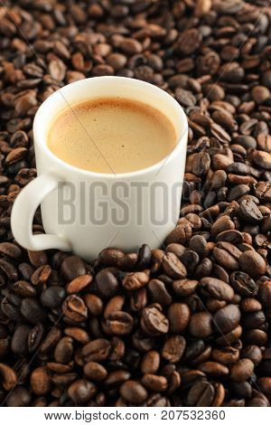 espresso coffee cup on background from cofee beans. vertical composition. close up